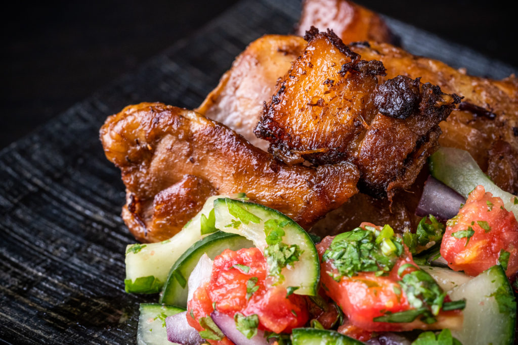 chicken and pork belly adobo, with the cucumber tomato relish