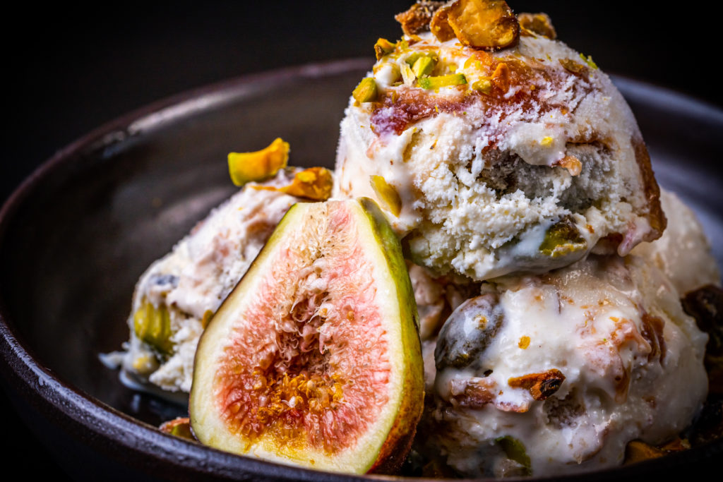 fig ice cream topped with pistachios