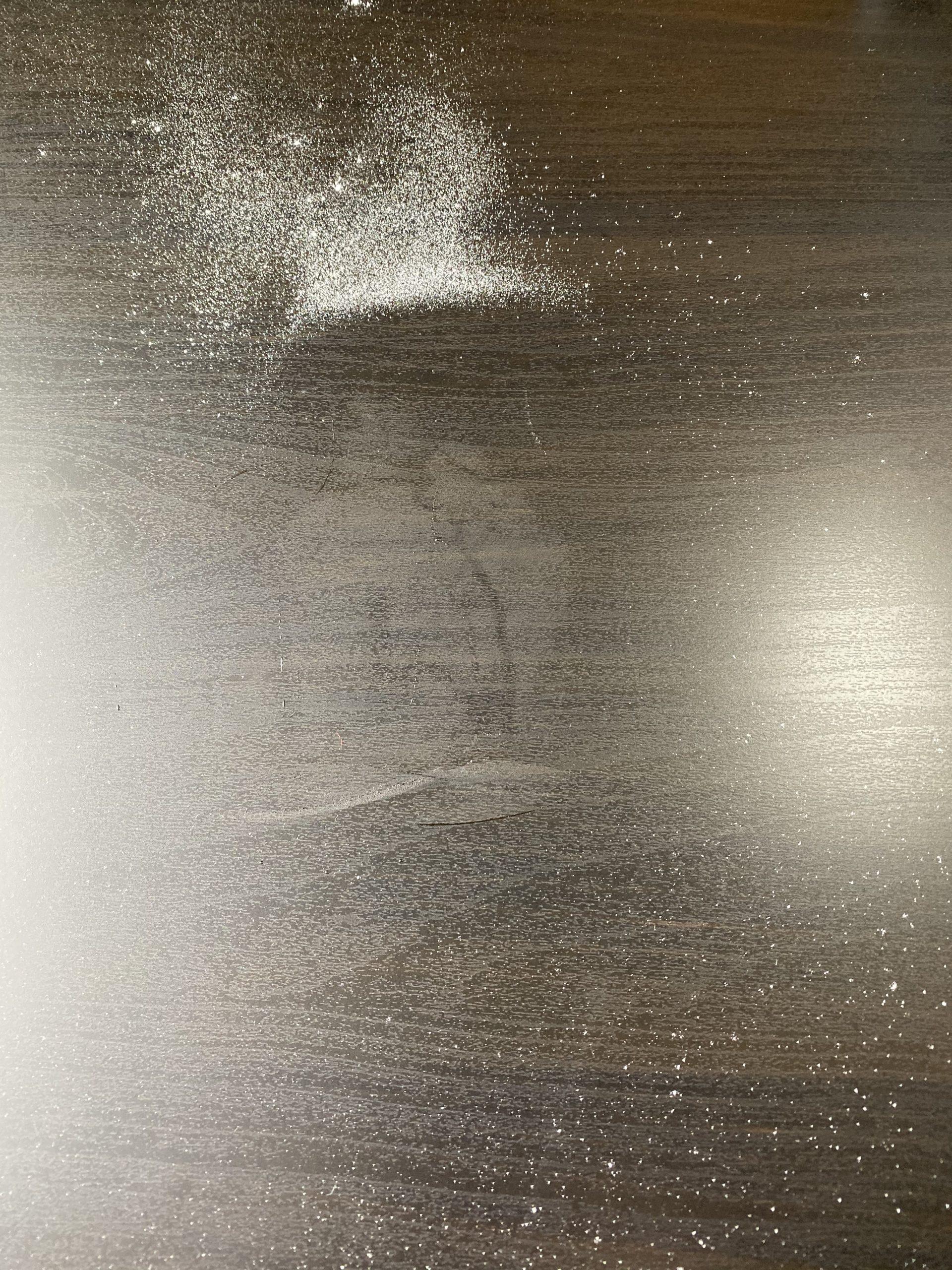 flour all over a black table