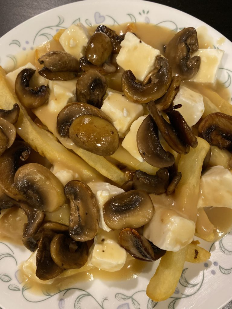 homemade poutine with mushrooms